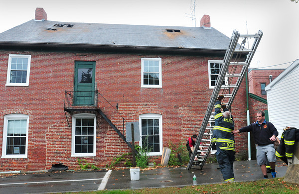 Amesbury: Amesbury firefighters practiced venting building fires by cutting holes in the roof of the Amesbury Town Hall Annex yesterday afternoon. The building which housed several town departments is slated to be demolished within a couple weeks. Bryan Eaton/Staff Photo