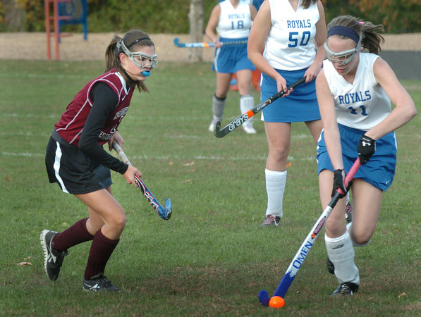 Georgetown: Georgetown's Vanessa Yavorski moves the ball down the field as Newburyport's Maddie Green moves in. Bryan Eaton/Staff Photo