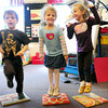 "Newbury: Twins Charlie Shanley, left, and Kiera, right, with Izzy Vadala, all 4, dance to the ""Funky Chicken"" in Mary Jo Lagana's pre-kindergarten class at Newbury Elementary School. The younsters were getting some excercise before their afternoon snack on Tuesday. Bryan Eaton/Staff Photo"