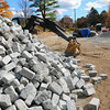 Newburyport: The paving stones that were in the rounabout are stacked near the entrance to Moseley Woods. Bryan Eaton/Staff Photo