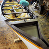 Amesbury: Lowell's Boat Shop staffer Gary Cassidy puts a final coat of paint on the whaleboat being built there. The boat will be launched on Sunday and moved to Mystic, Conn. next spring. Bryan Eaton/Staff Photo