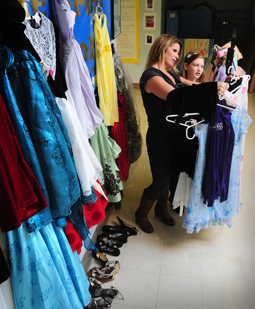 Rowley: Pine Grove sixth-grader and student council member Julia Watson, 11, right, with class advisor Nicole LaPerriere, had the idea to ask school parents to donate slighty worn dresses for girls to wear at the upcoming Pumpkin Ball to keep costs down for those wishing to attend. The student council backed Julia's idea and are assisting with the collection of the dresses and shoes. Bryan Eaton/Staff Photo