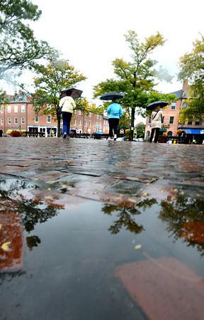 Newburyport: Puddles cover Market Square in Newburyport on a damp Sunday afternoon. Jim Vaiknoras/staff photo