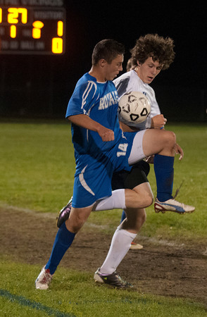 Byfield: Triton's Peter Stacy fights for the ball with Georgetown's Will Soucy during their game at Triton Thursday night. Jim Vaiknoras/staff photo