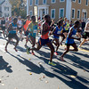 Newburyport: Runners cast long shadows at the start of the Newburyport Green Stride Half Marathon in Newburyport Sunday afternoon. JIm Vaiknoras/staff photo