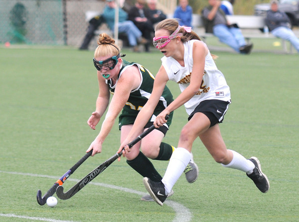 Amesbury: Newburyport's Michaela Corvi fights for the ball with a North Reading player during their game at Amesbury Sports Park Thursday. Jim Vaiknora/staff photo