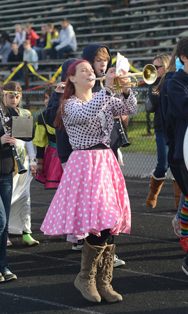 Byfield: Triton band member Maddy Solomon helps lead the Horrables Parade around the track at Triton is Haunted at Triton Saturday. Jim Vaiknoras/staff photo