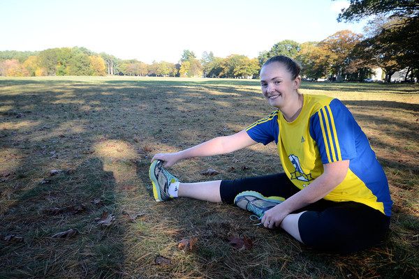 Newburyport: Caitlin Stokes, stretches before running in Maudslay State Park this former Pentucket runner will be running the Boston Marathon next year after watching from the finish line when bombs went off. Jim Vaiknoras/staff photo
