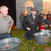 Newburyport: Claude Elias, Jeff Brunelle and Jeff Grey bob for apples at the Historical Society's Halloween Hauntings fundraiser at Oak Hill cemetery Friday night, Jim Vaiknoras/staff photo