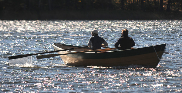 Amesbury: Bill Goth and Ken Jackman compete in the 3rd annual Mighty Merrimack Rowing Race at Lowell Boat Shop Sunday. The race was limited to traditional wooden boats. Jim Vaiknoras/staff photo