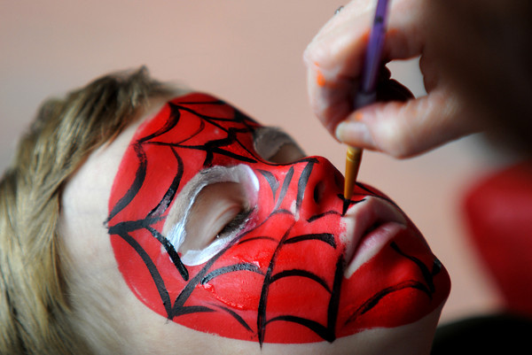 Amesbury: Micah Slelicki, 4, visiting from Lebonon NH, is transformed into Spiderman by the magic of face painting at teh Fall Festival in Market Square in Amesbury Saturday afternoon. Jim Vaiknoras/staff photo