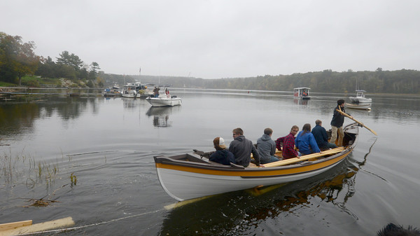 Amsbury: Seven apprentices paddle the whale boat they helped build at the Lowell Boat shop in Amesbury Sunday.A large crowd gathered for it's launch Sunday afternoon. Jim Vaiknoras/staff photo