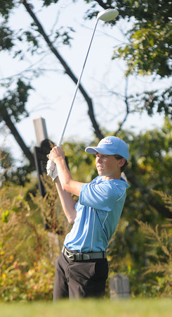 Byfield: Triton golfer Jake Apunas tees of at Ould Newbury during the Viking's match against Rockport Wednesday. Jim Vaiknoras/staff photo