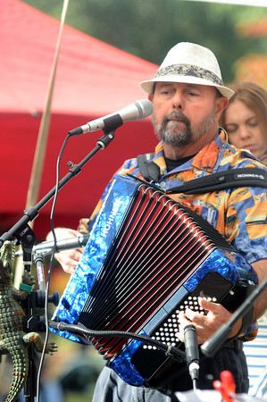 Newburyport: Ralph Tufo of the Squeezebox Stompers entertains in Market Square during Newburyport Harvest Feastival this weekend. Jim Vaiknoras/staff photo