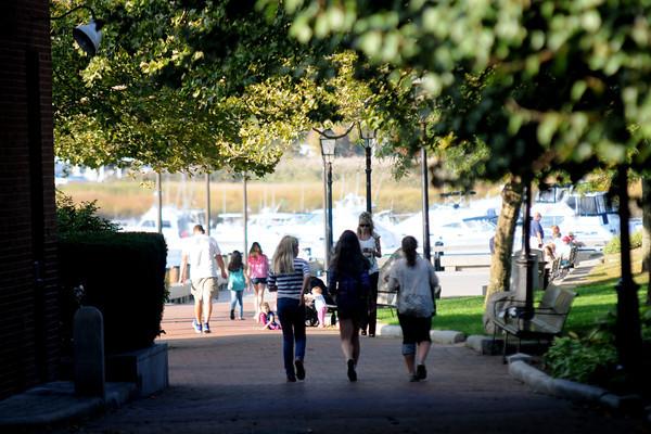 Newburyport: Trees frame pedestrians as they enjoy a warm October day in Market Landing Park in Newburyport. Jim Vaiknoras/staff photo