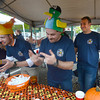 Amesbury: Pete Davekos, Ian Murphy and Sean McGregor of the Cataldo/Atlantic Ambulance Chili Enthusiasts explain their gelitan based costumizable spicing method at the annual Fireman's 2013 Chili Cook-Off at the Barking Dog Parking lot in Amesbury Saturday. Jim Vaiknoras/staff photo