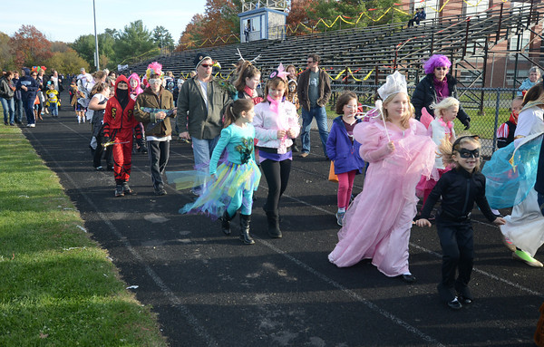 Byfield: Witches, superheros, and assorted goblins and princesses walk around the track at Triton is Haunted at Triton Saturday. Jim Vaiknoras/staff photo
