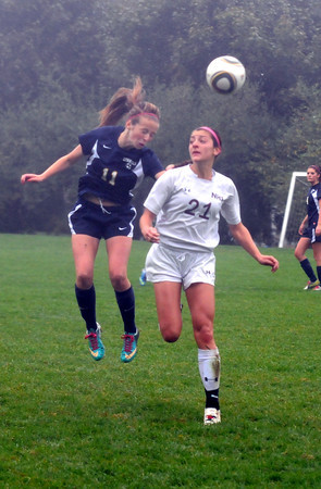 Newburyport: Newburyport's Maryam Moshrefi goes up for a header with a Lynnfield player during their game at Cherry Hill in Newburyport Saturday. Jim Vaiknoras/staff photo