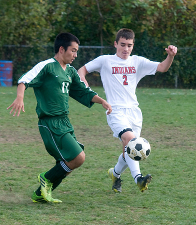 Amesbury: Amesbury's Kyle Mirley fight for the ball with a North Reading player during their game at Amesbury Middle School. JIm Vaiknoras/staff photo
