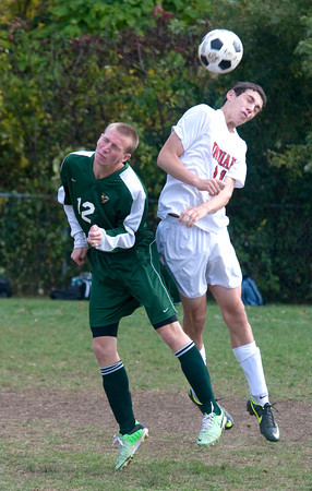 Amesbury: Amesbury's Collum Holmes goes up for a header with a North Reading player during their game at Amesbury Middle School. JIm Vaiknoras/staff photo