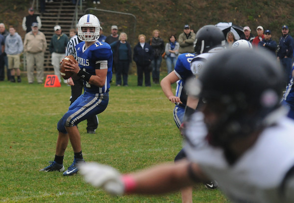 Georgetown: Georgetown's Daniel Lambert looks down field for a reciever during the Royal's  game against Lynnfield at Georgetown Saturday. Jim Vaiknoras/staff photo