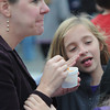 Amesbury: Olivia Panteledes, 9, of Newburyport fans her mouth after trying her mom Paula's chili at the Amesbury Fireman's Chili Cook-Off at tthe Barking Dog Parking lot Saturday. Jim Vaiknoras/staff photo