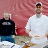 Newburyport: Matt Bradley and Joe Sargent from the Grog serve up chili at the The Chili Con-Carnival in the Grog parking lot in Newburyport Saturday. Jim Vaiknoras/staff photo