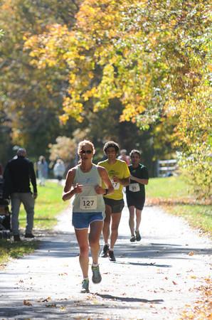 Newburyport: Runner in the NewburyportGreenStrideHalfMarathon make their way under the fall foliage on the Rail Trail in Newburyport Sunday afternoon. JIm Vaiknoras/staff photo
