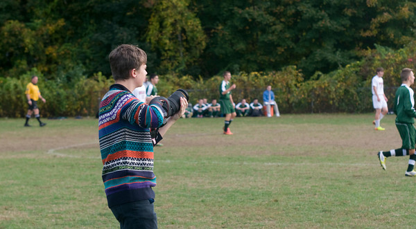 Amesbury: Matt Lavoie , 16 of Amesbury takes photo of the Amesbury high soccer team during their game against North Reading Friday at Amesbury Middle School. Matt is a sophmore at Amesbury High and is shooting photo for the high school newspaper, JIm Vaiknoras/staff photo