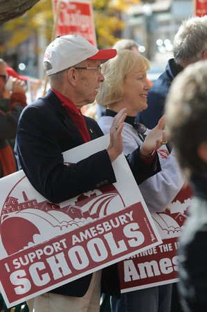 "Amesbury: Educators Peter and Patty Hoyt hold signs in support of Amesbury Schools at the ""I am Pro Amesbury"" in Market Square in Amesbury Sunday afternoon. Jim Vaiknoras/staff photo"