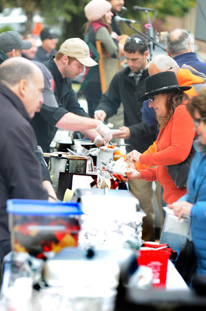Newburyport: People sample chili from local eateries at the The Chili Con-Carnival in the Grog parking lot in Newburyport Saturday. Jim Vaiknoras/staff photo