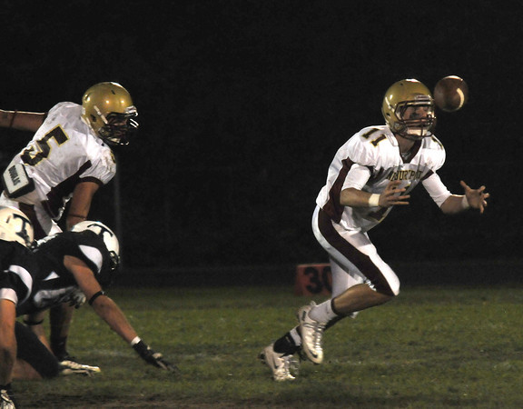 Byfield: Newburyport Quarterback  Michael Shay bobbles the ball against Triton during their game at Triton Friday night. Jim Vaiknoras/staff photo
