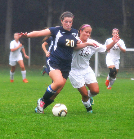 Newburyport: Newburyport's Jaycie Trianafilou fights for the ball with a Lynnfield player during their game at Cherry Hill in Newburyport Saturday. Jim Vaiknoras/staff photo