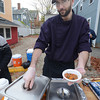 Newburyport: Patrick Abenant of the Carrry Out Cafe serves up chili at the The Chili Con-Carnival in the Grog parking lot in Newburyport Saturday. Jim Vaiknoras/staff photo