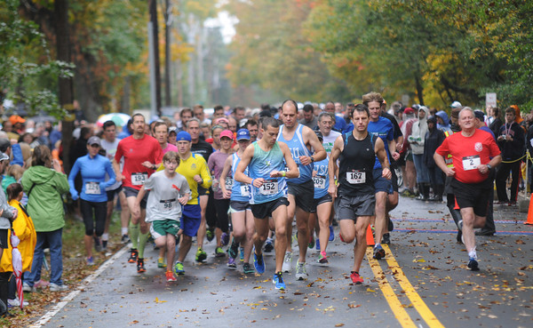 West Newbury: Runner take off at the start of the annual Apple Harvest 5 mile road race Sunday in West Newbury. Jim Vaiknoras/staff photo