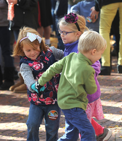 """Amesbury: Sisters Paige and Carly Testa, 4, dance with their friend Julian Sherwood, 6, at  the """"I am Pro Amesbury"""" in Market Square in Amesbury Sunday afternoon. Jim Vaiknoras/staff photo"""