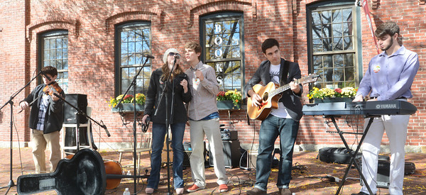 """Amesbury: Local band Merrimac Hat Company, made up of all Amesbury musicians, perform at the """"I am Pro Amesbury"""" Rally in Market Square in Amesbury Sunday. Jim Vaiknoras/staff photo"""