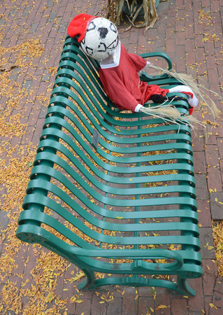 Amesbury: A soccer inspired scarecrow sits on a green metal bench in Market Square in Amesbury.  Jim Vaiknoras/staff photo