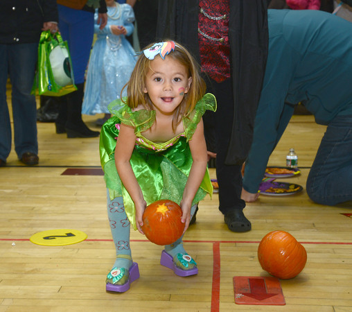 Newburyport: Piper Marino, 4, tries her hand at pumpkin bowling at the Brown School and Newburyport Elementary PTO  annual BOO BASH Fridat night. Jim Vaiknoras/staff photo