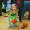 Newburyport: Piper Marino, 4, tries her hand at pumpkin bowling at the Brown School and Newburyport Elementary PTO  annual BOO BASH Fridat night. Jim Vaiknoras/staff photo