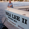 Newburyport: Bob Yeomans aboard his boat the Erica Lee II docked on the Newburyport waterfront. Jim Vaiknoras/staff photo