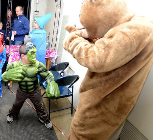 Newburyport: Jack Staunton , 6, dressed as the Hulk prepares to smash the Brown School bear at the Brown School and Newburyport Elementary PTO  annual BOO BASH Fridat night. Jim Vaiknoras/staff photo