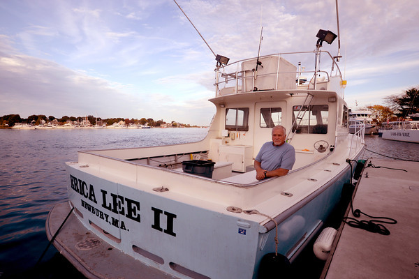 Newburyport: Bob Yeomans aboard his boat the Erica Lee II docked on the Newburyport waterfront. Jim Vaiknoras/staff photo