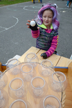 Salisbury: Jasmine Rulli, 6, plays a Ping Pong game at the Fall Festival at Lion's Park in Salisbury Saturday afternoon. Jim Vaiknoras/staff photo