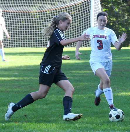 Amesbury: Amesbury's Hayley Tagliente fights for the ball against Ipswich at the Cashman School field in Amesbury Monday. Jim Vaiknoras/staff photo