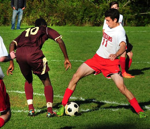 BRYAN EATON/ Staff Photo. Amesbury's Collum Holmes tries to keep the ball from Newburyport's King Shema.