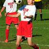 BRYAN EATON/ Staff Photo. Amesbury's Drew Everett directs the ball into Newburyport field.