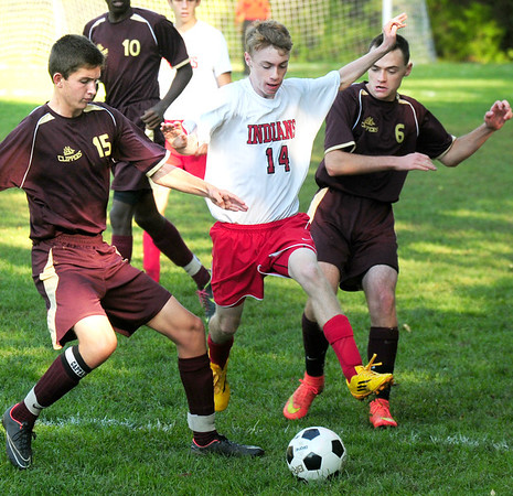 BRYAN EATON/ Staff Photo. Amesbury's Brian Edmonds is flanked by Clippers' Matt Cote, left, and Spencer Reap.