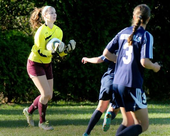 BRYAN EATON/ Staff Photo. Newburyport goalie Georgia Kacher catches the ball in a Hamilton-Wenham scoring attempt.