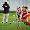 BRYAN EATON/Staff Photo. Triton's Samantha Brown and Amesbury's Hayley Cantania move down the field.